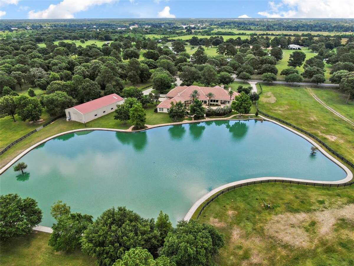 Located at 18455 Cypress Rosehill Road, this $3 million Mediterranean masterpiece comes with its own one-acre private lake equipped with a jogging track.