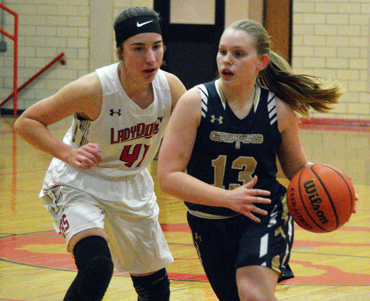 Father McGivney's Rachel Maller (right) dribbles past's Analise Best during Monday's game in Staunton.
