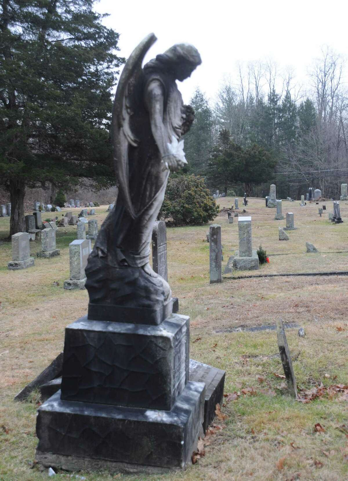 Old stones and statues mark the graves at Branchville Cemetery. The town is working to gain title to the graveyard, which dates to the mid 1800s.