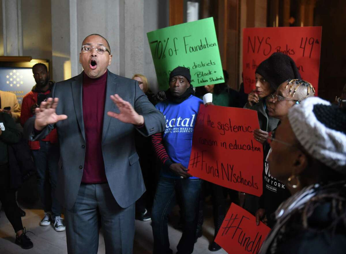 Anthony Dixon, director of community engagement for the Parole Preparation Project, was one of the activist and community leaders who spoke during the inaugural Black State of the State of New York on Tuesday, Jan. 7, 2020, at the Capitol in Albany, N.Y. Advocates gathered to rally for legislative action they say is needed to end racial inequality. In 2021, advocates continue to try for parole reforms with a new set of legislative efforts. (Will Waldron/Times Union)