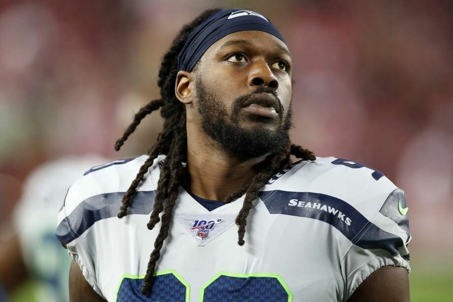 "General manager John Schneider, with coach Pete Carroll on a Zoom call Tuesday with local media, said the door is ""not closed"" on the team re-signing defensive end Jadeveon Clowney. Photo: Rob Leiter/Getty Images"