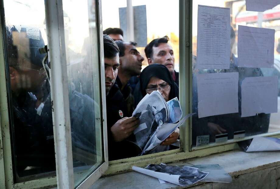 Relatives check lists of victims at an information office of a hospital in the southeastern city of Kerman following a stampede that broke out at the funeral of Gen. Qassem Soleimani. Photo: Atta Kenare / AFP Via Getty Images