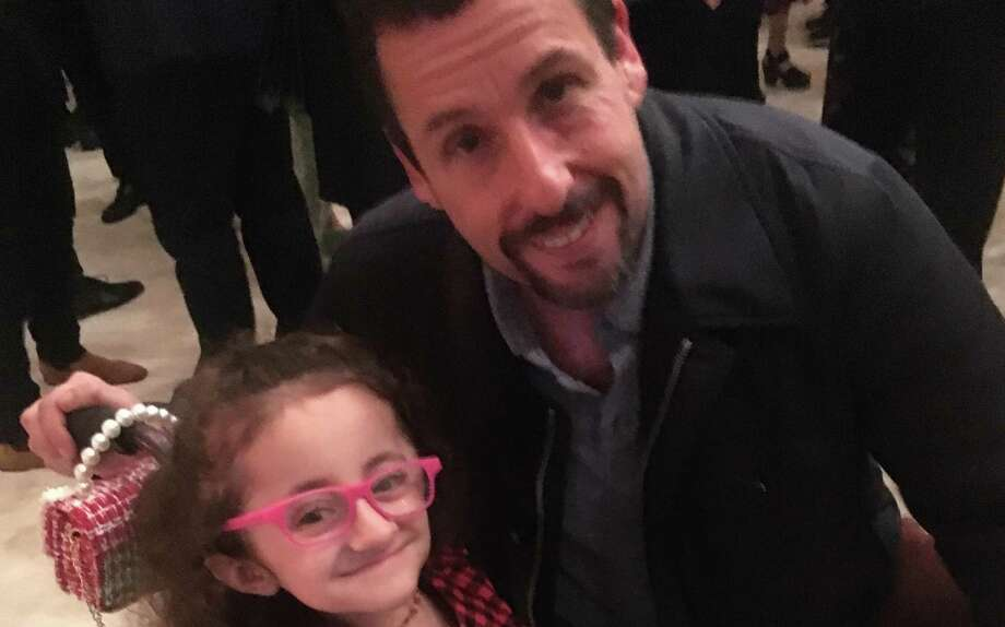 San Antonio girl Sammi Haney poses with Adam Sandler at a Netflix party. The nine-year-old will return to the Netflix series 'Raising Dion' for its second season, which goes into production in 2020. Photo: Courtesy Matt Haney