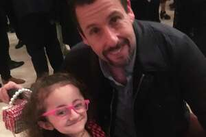San Antonio girl Sammi Haney poses with Adam Sandler at a Netflix party. The nine-year-old will return to the Netflix series 'Raising Dion' for its second season, which goes into production in 2020.