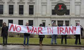 An anti-war rally is hosted by United Activists of Fort Wayne Indiana and Fort Wayne for Peace to protest for peace and diplomacy in response to the latest U.S. airstrike of Iraqis, at the Allen County Courthouse in Fort Wayne, Ind., Saturday, Jan. 4th, 2020. (Katie Fyfe/The Journal-Gazette via AP)