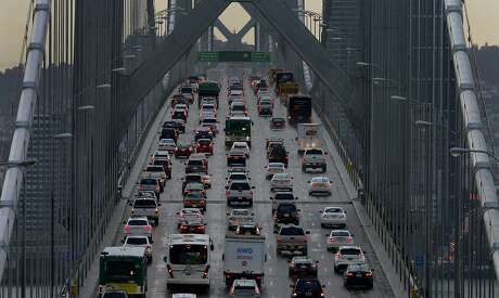 FILE - In this Dec. 10, 2015, file photo, vehicles make their way westbound on Interstate 80 across the San Francisco-Oakland Bay Bridge as seen from Treasure Island in San Francisco. California Gov. California regulators will hold a public hearing on Thursday, Dec. 12, 2019 about whether to require a certain percentage of truck sales to be zero emission vehicles. California has some of the worst air quality in the nation, largely driven by pollution from cars and trucks. (AP Photo/Ben Margot, File)