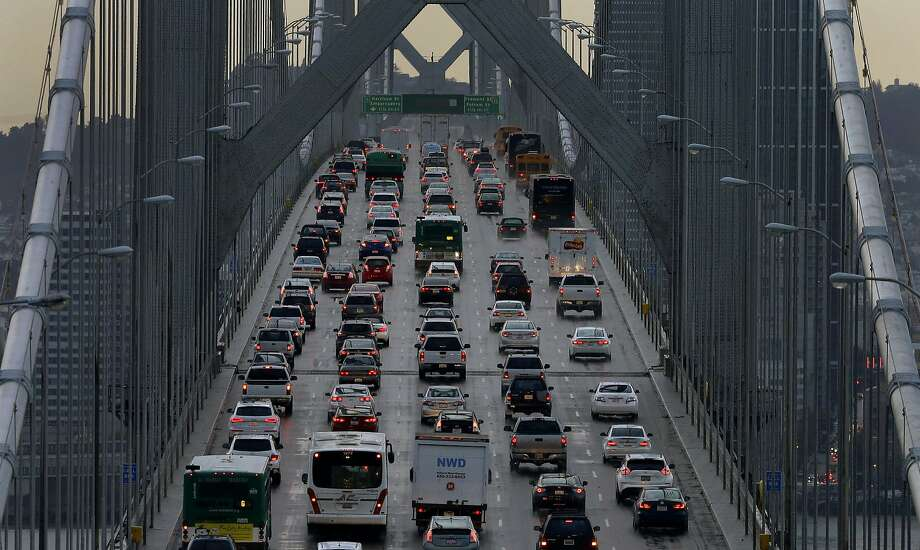 Westbound cars on the Bay Bridge in December 2015. Bay Area Rep. Mark DeSaulnier is introducing legislation that would require federal agencies to buy only vehicles from manufacturers that meet Obama-era emissions standards. Photo: Ben Margot / Associated Press