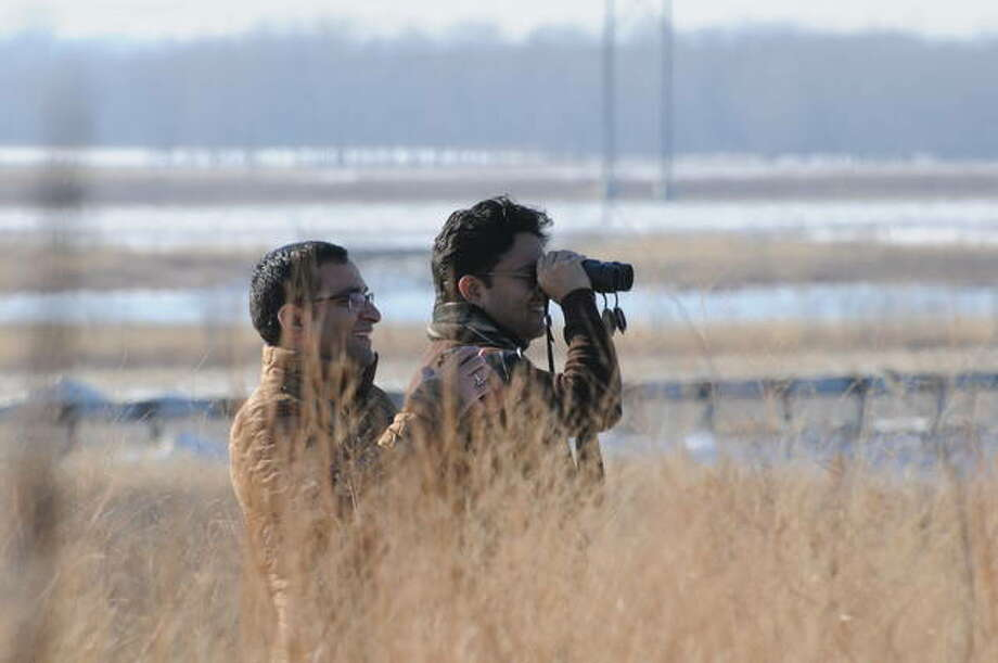 Sumit Joshi and Sidhartha Mahali of St. Louis observe winter birds Dec. 21 at the Audubon Center at the Riverlands. Weather analysts say December 2019 was one of the warmest and driest months the state has seen; in Alton, temperatures reached 66 degrees on Dec. 27. For 16 days in December, Alton temperatures reached at least 50 degree.
