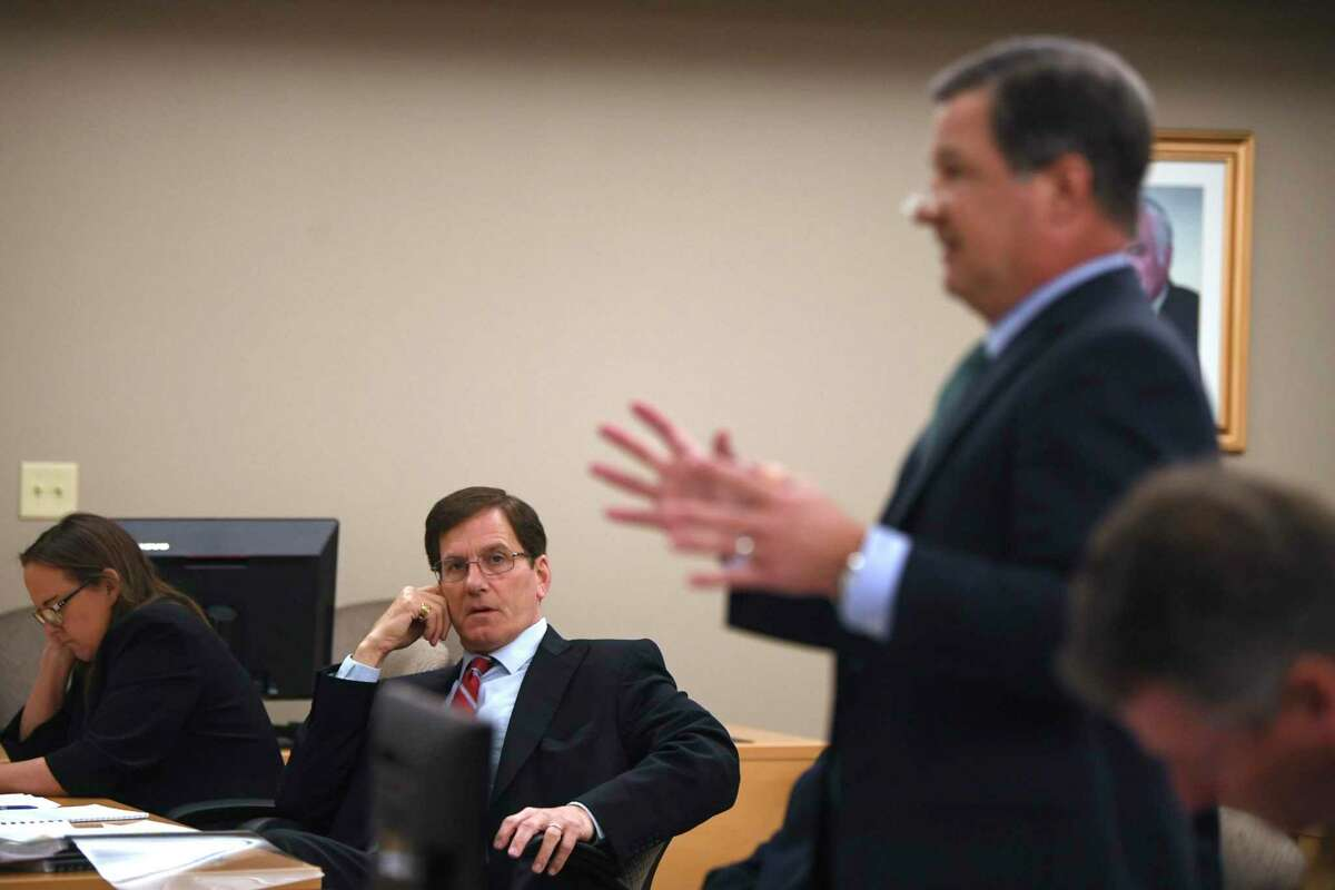 Douglas Sutter, left, attorney for lake area property owners, listens as Travis J. Sales, attorney for the Guadalupe-Blanco River Authority, speaks during a hearing in Seguin at which Sutter asked Visiting Judge Stephen B. Ables to compel the GBRA to turn over documents on Tuesday, Jan. 7, 2020. Six aging dams owned by the GBRA have failed or are in danger of failing.