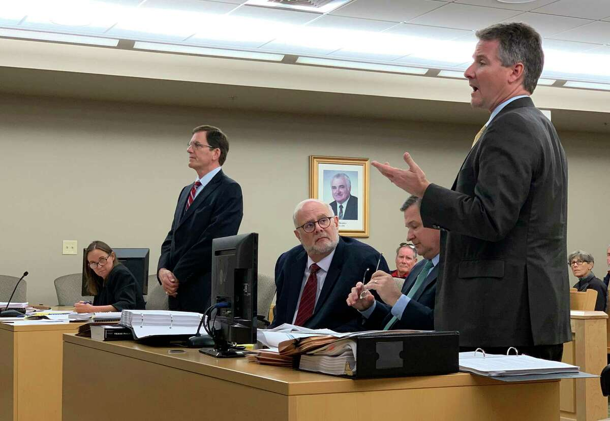 Guadalupe-Blanco River Authority attorney Kevin Jacobs, right, speaks as GBRA senior advisor to the General Manager Thomas Hill, middle, listens during a hearing in Seguin. Lake property owners' attorney Doug Sutter, standing at left, asked Visiting Judge Stephen B. Ables to compel the GBRA to turn over documents related to their case on Tuesday, Jan. 7, 2020.