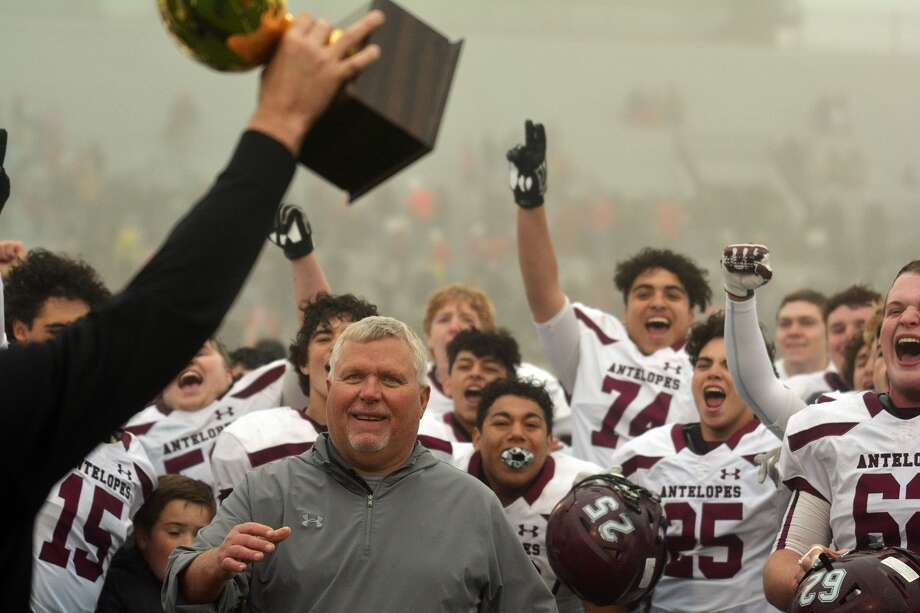 Darrell Daily and the Abernathy football team celebrate the unveiling and their latest gold ball trophy after defeating Friona in the regional round of the Class 3A-Division II football playoffs earlier this season. Photo: Nathan Giese/Planview Herald