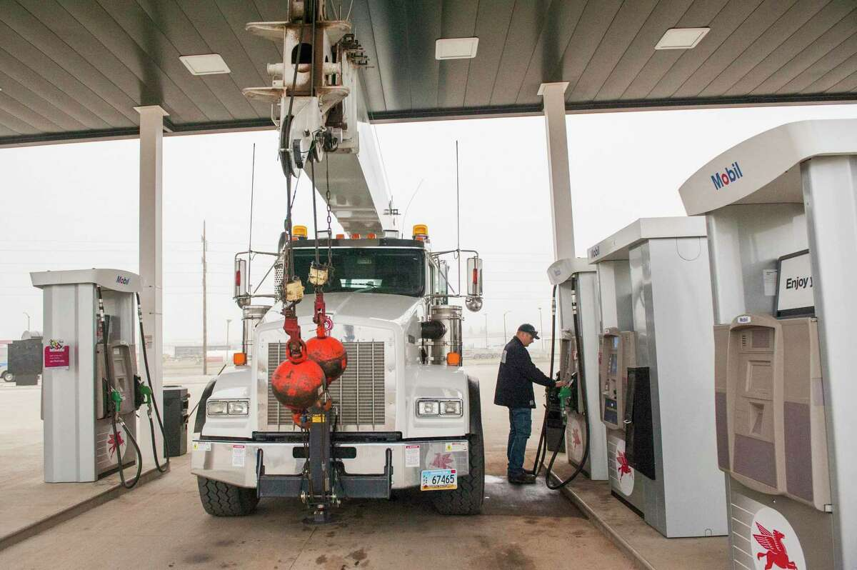 A customer uses a credit card at the Hub, a gas station and convenience store, in Dickinson, N.D. Jared Scheeler, an owner of the Hub, said in 2015 it cost the average convenience store $26,000 to upgrade its gas pumps and point-of-sale terminals for the new security chip in credit and debit cards.