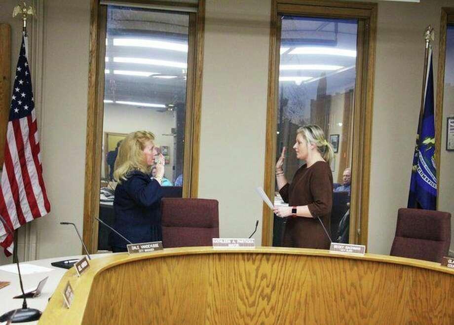 Bad Axe City Clerk Rebecca Bachman swears in Mayor Kathleen Partika. (Sara Eisinger/ Huron Daily Tribune)