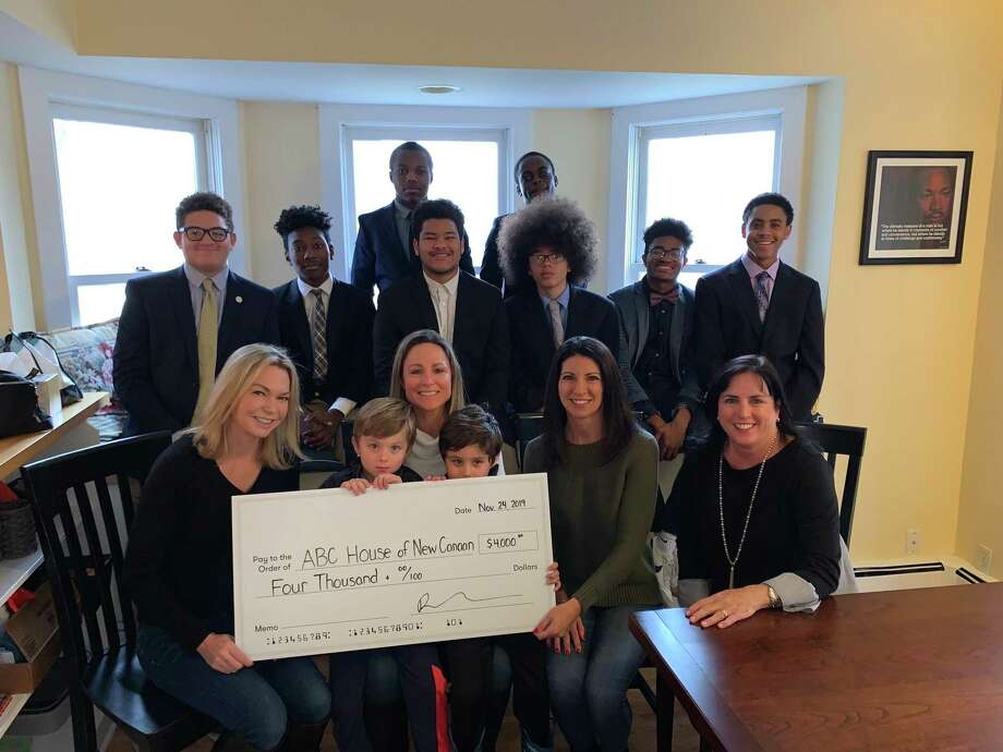 The scholars of A Better Chance of New Canaan were recently presented with $4,000 raised by the restaurants, The White Buffalo, and 84 Sports at a recent fashion show. Pictured are: Bottom row: Joanna Tonkavich, (White Buffalo); Erin Hoffman, (84 Sports), with her twin sons Cole, and Brody; Annmarie Valente, (White Buffalo); Susan Donnelly (ABC Board President); Middle row: ABC Scholars Javier Perez, Axel Boly, Richard Hernandez, Ivan Tamayo, Ajamo Carraby-Jones and Adrian Davis; Back row: ABC Scholars Dylan Amaswache and Osasu Uwa-Omede. Photo: Contributed Photo