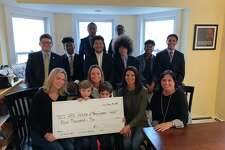 The scholars of A Better Chance of New Canaan were recently presented with $4,000 raised by the restaurants, The White Buffalo, and 84 Sports at a recent fashion show. Pictured are: Bottom row: Joanna Tonkavich, (White Buffalo); Erin Hoffman, (84 Sports), with her twin sons Cole, and Brody; Annmarie Valente, (White Buffalo); Susan Donnelly (ABC Board President); Middle row: ABC Scholars Javier Perez, Axel Boly, Richard Hernandez, Ivan Tamayo, Ajamo Carraby-Jones and Adrian Davis; Back row: ABC Scholars Dylan Amaswache and Osasu Uwa-Omede.