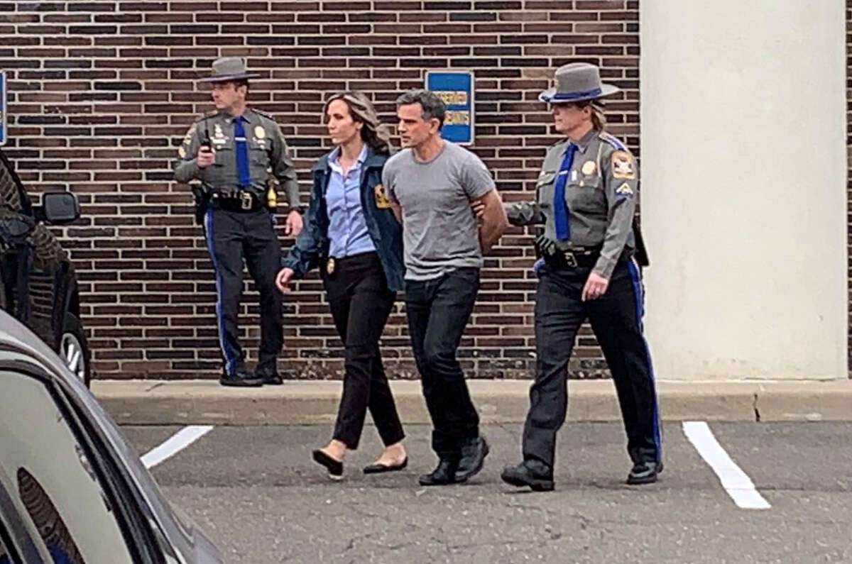 Fotis Dulos being escorted out of Troop G in Bridgeport after being charged charged in Jennifer Dulos' murder Tuesday Jan. 7, 2020.