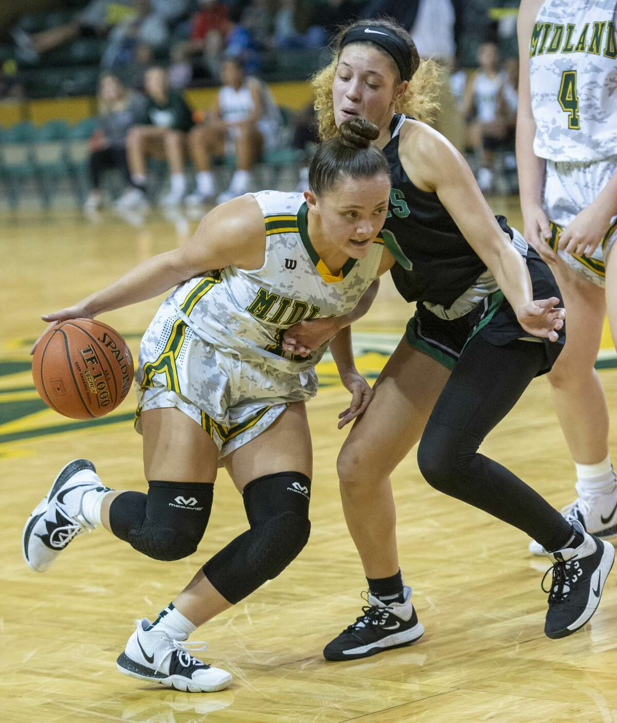 Midland College's Kayla Anderson drives the ball past Seward County's Tianna Johnson on Nov. 21, 2019 at Chaparral Center.