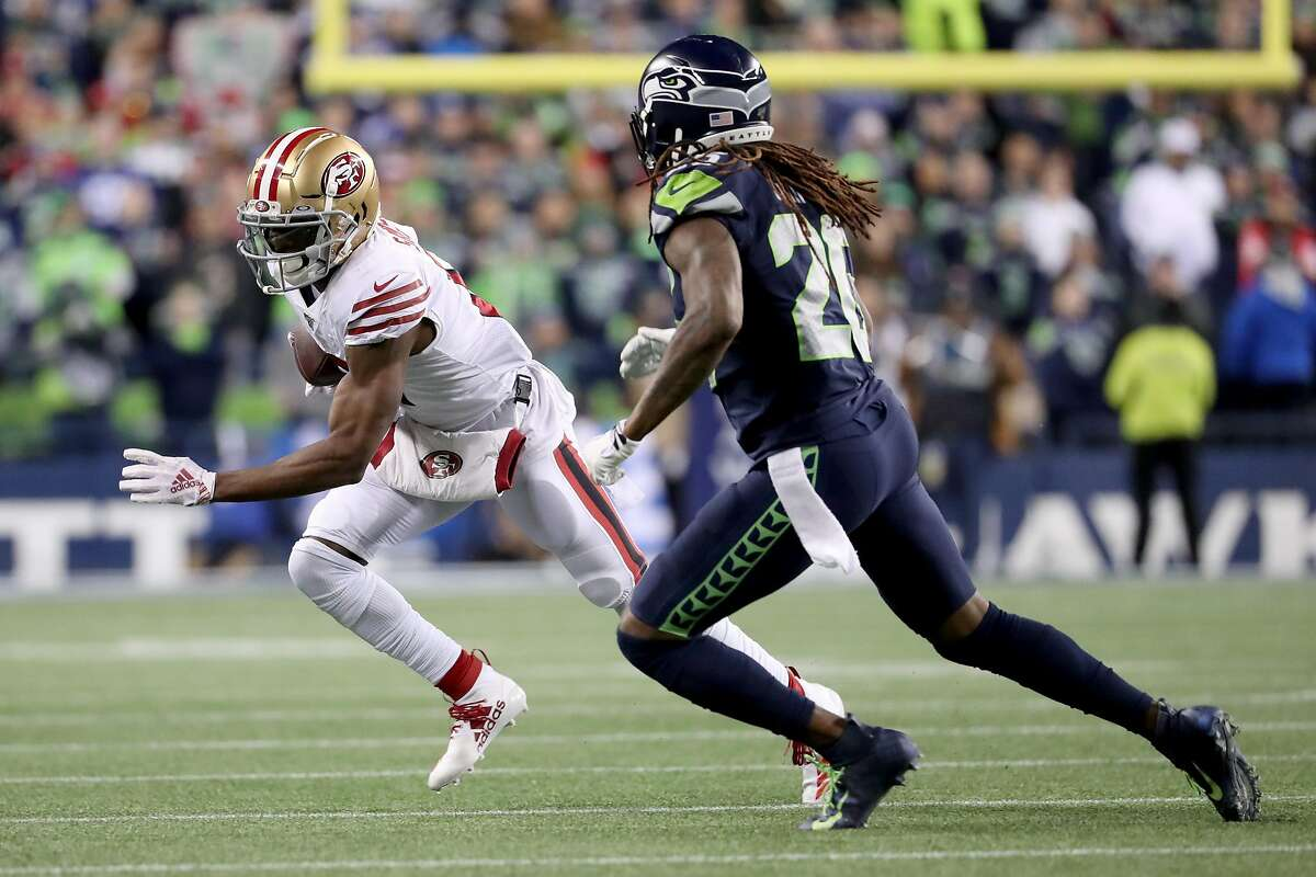 SEATTLE, WASHINGTON - DECEMBER 29: Wide receiver Emmanuel Sanders #17 of the San Francisco 49ers runs against cornerback Shaquill Griffin #26 of the Seattle Seahawks during the second quarter of the game at CenturyLink Field on December 29, 2019 in Seattle, Washington. (Photo by Abbie Parr/Getty Images)