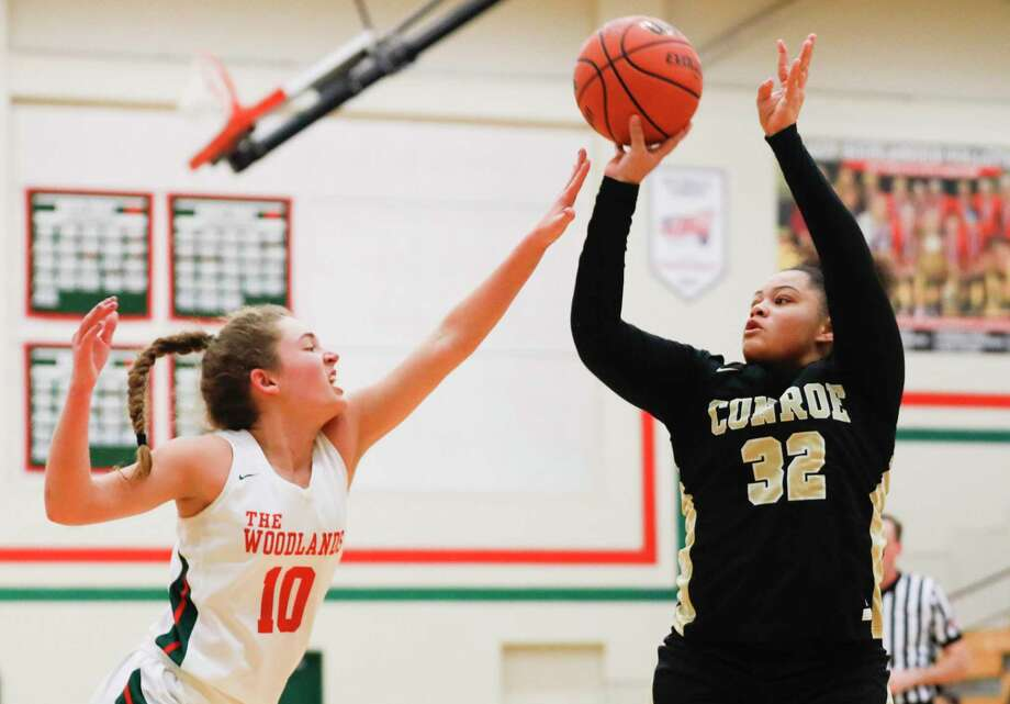 In this file photo, Conroe guard Isabella Stafford (32) shoots a three-pointer over The Woodlands guard Anna-Claire Biggerstaff (10) during the first quarter of a District 15-6A high school basketball game at The Woodlands High School, Tuesday, Dec. 31, 2019, in The Woodlands. Photo: Jason Fochtman, Houston Chronicle / Staff Photographer / Houston Chronicle