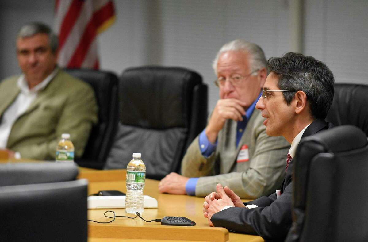 Parents, students and city officials listen to Board of Education candidates (from left) Mike Altamura (R), David Mannis (D), and Frank Cerasoli (R) as they answered questions during the Angela Lorenti Memorial 2018 Board of Education Candidates Forum at the Stamford Government Center on Wednesday, Oct. 24, 2018 in Stamford, Connecticut.