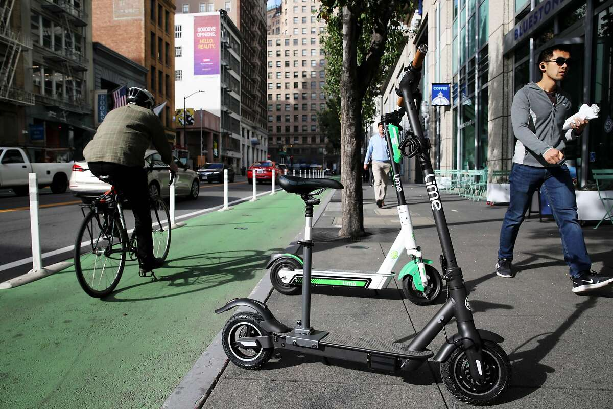 The new Lime scooter, with a seat designed for people with mobility issues, rests near Mission and Second streets, in San Francisco, Calif., on Tuesday, January 7, 2020. The scooter can be reserved and the company will drop it off and pick it up from wherever you need it after 24 hours.