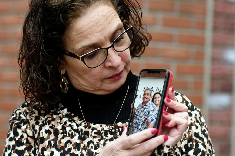 Micky Jimenez, executive director of Capital District Latinos, holds a photo of her brother, Jorge Hernandez, on Tuesday, Jan. 7, 2020, outside her Central Avenue offices in Albany, N.Y. Jimenez lost contact with her sibling after the Caribbean island was struck by earthquakes. (Will Waldron/Times Union)