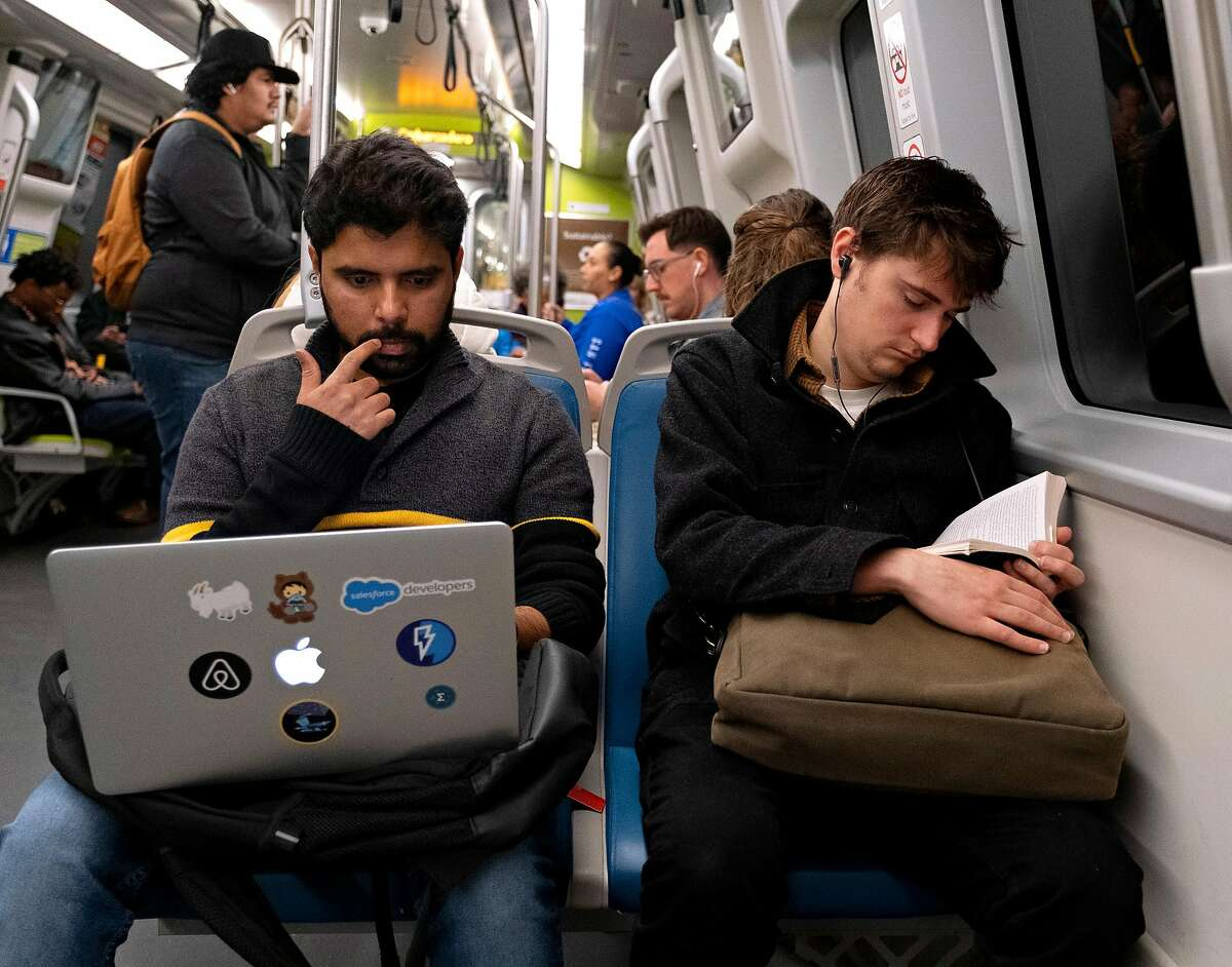 Jay Kumar uses his computer while traveling on BART toward West Oakland in San Francisco, Calif. on Tuesday, January 7, 2020.