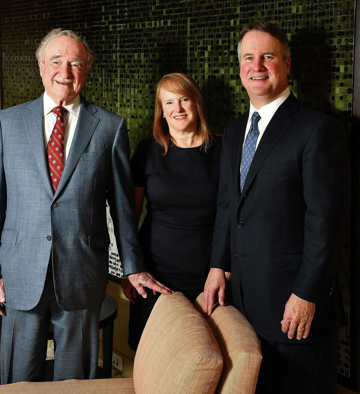 Attorney Harry Reasoner with his son Barrett and daughter Macey at the offices of Vinson & Elkins downtown on Oct. 17, 2019.