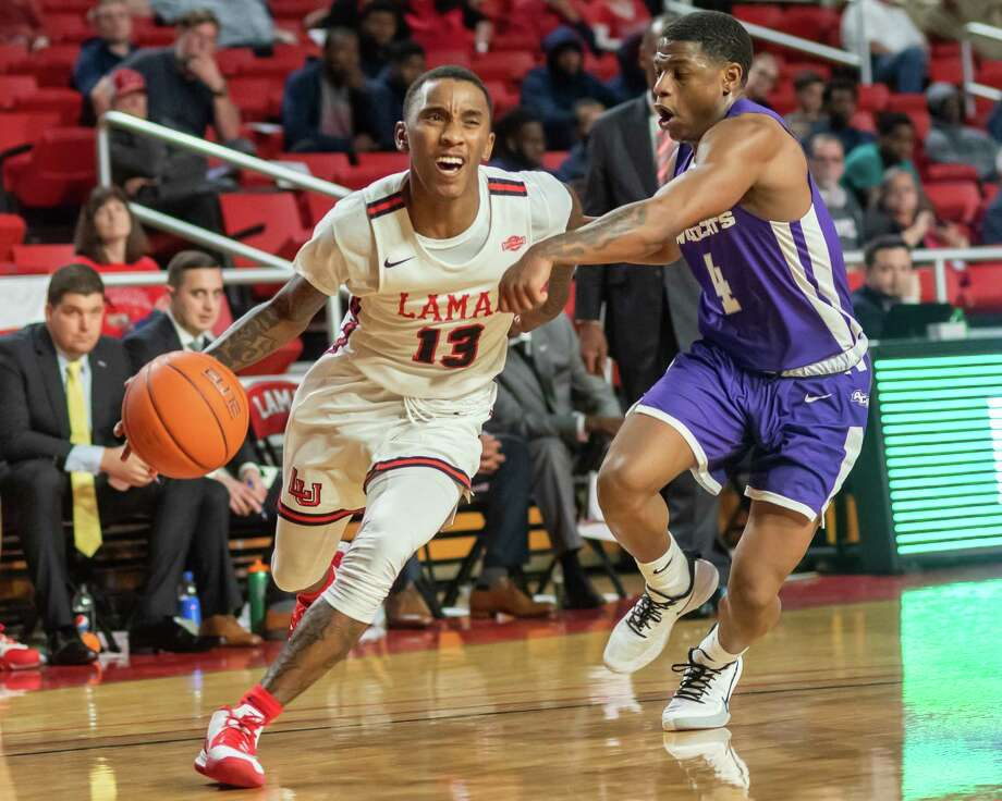 Davion Buster (13) drives around Damien Daniels (4) as the Lamar Cardinals were in a hard-fought battle in their game with the Wildcats of Abilene Christian at the Montagne Center on Saturday, January 4, 2020. Fran Ruchalski/The Enterprise Photo: Fran Ruchalski/The Enterprise / 2019 The Beaumont Enterprise