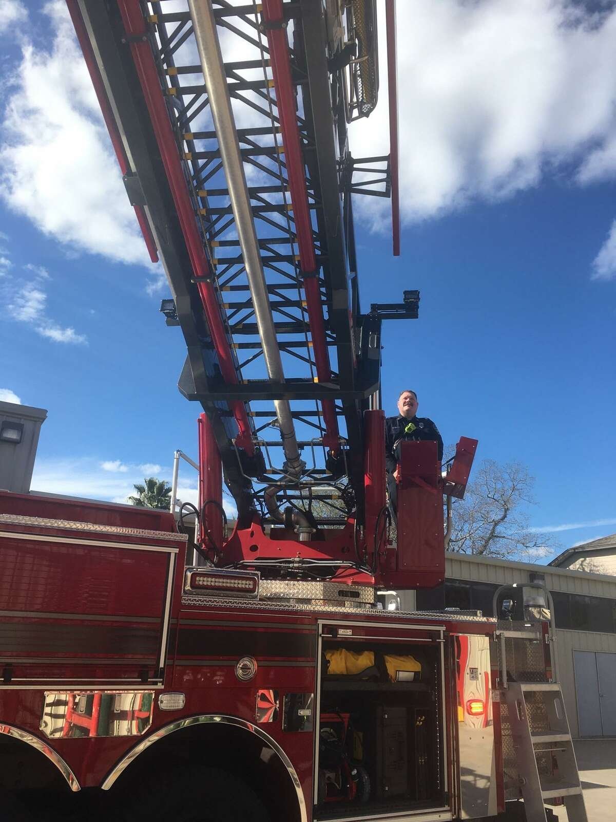 Edward Thraen, engine operator, controls the 107-foot ladder on a new aerial/pumper truck that the Katy Fire Department recently added to its fleet.