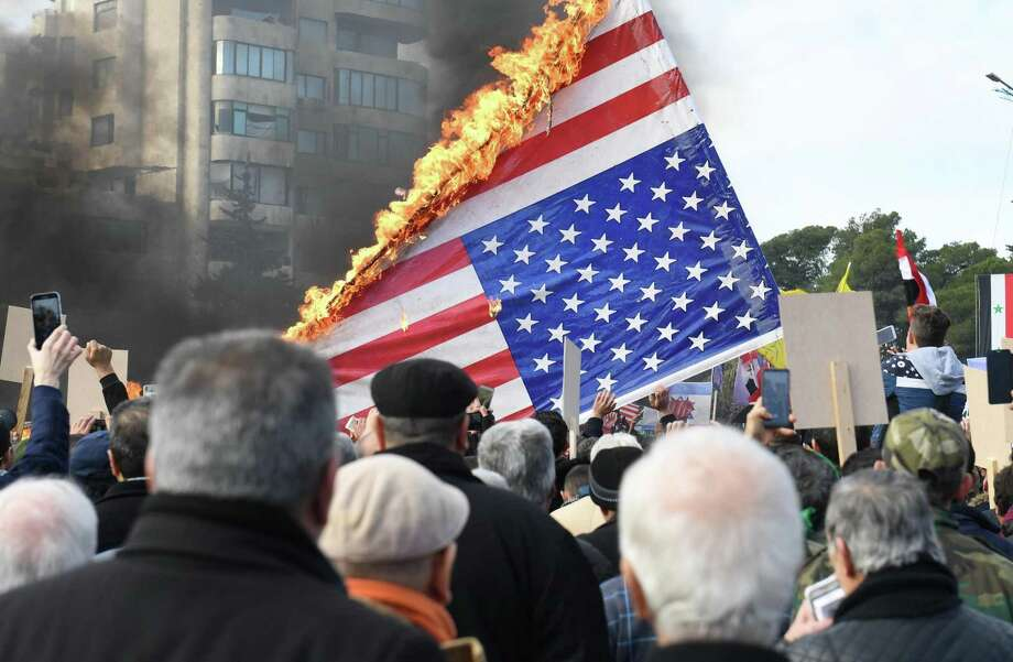 Syrian demonstrators burn the US flag as they gather in the central Saadallah al-Jabiri square in the northern Syrian city of Aleppo on January 7, 2020, to mourn and condemn the death of Iranian military commander Qasem Soleimani, and nine others in a US air strike in Baghdad. (Photo by - / AFP) (Photo by -/AFP via Getty Images) Photo: -, Contributor / AFP Via Getty Images / AFP or licensors