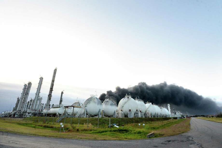 Thick smoke fills the sky above the TPC plant in Port Neches as emergency response crews try to contain the fire that continued to burn throughout the morning following an overnight explosion. Several homes and businesses and Port Necehs High School and other city buildings suffered damage from the blast. Photo taken Wednesday, November 27, 2019 Kim Brent/The Enterprise Photo: Kim Brent / The Enterprise / BEN