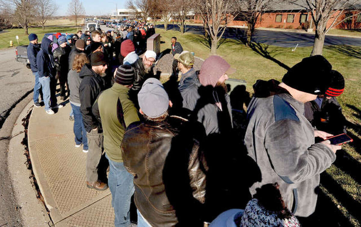 A line stretched for blocks as customers wait to make a legal purchase of cannabis at HCI in Collinsville Wednesday. Cannabis became legal in Illinois on the first day of 2020.