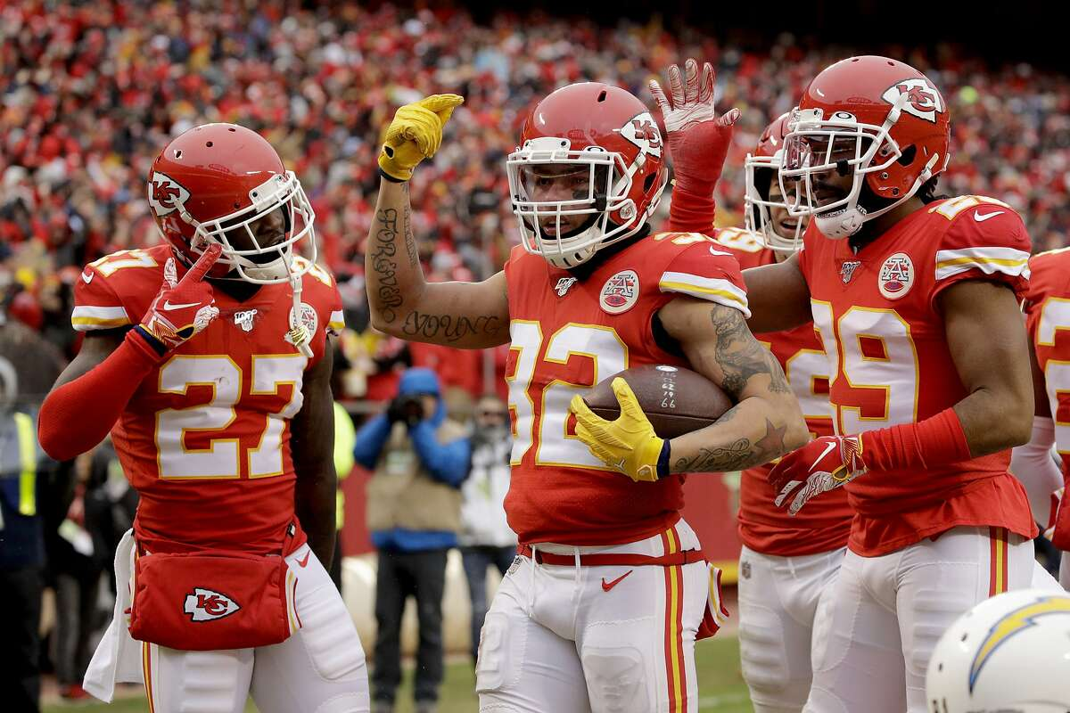 Kansas City Chiefs safety Tyrann Mathieu, center, celebrates between cornerback Rashad Fenton (27) and cornerback Kendall Fuller (29) after he intercepted a pass intended for Los Angeles Chargers wide receiver Mike Williams during the first half of an NFL football game in Kansas City, Mo., Sunday, Dec. 29, 2019. (AP Photo/Charlie Riedel)