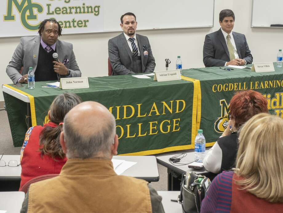 Candidates for Midland City Council District 2, from left, John Norman, Adrian Urquidi and Steven Villela, speak 01/07/20 during a public forum at the Cogdell Learning Center. Tim Fischer/Reporter-Telegram Photo: Tim Fischer/Midland Reporter-Telegram