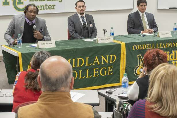 Candidates for Midland City Council District 2, from left, John Norman, Adrian Urquidi and Steven Villela, speak 01/07/20 during a public forum at the Cogdell Learning Center. Tim Fischer/Reporter-Telegram