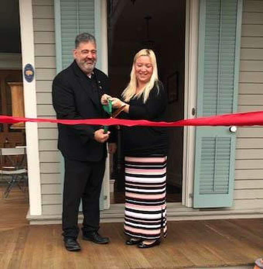 Krysta Perrone-Rondini is shown above with New Milford Mayor Pete Bass at the ribbon-cutting ceremony celebrating Accurate Answer's move to downtown New Milford. Photo: Contributed Photo / Contributed Photo / The News-Times Contributed