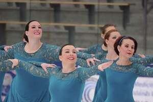 Synchronized skaters perform