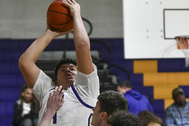 Midland High's Brett Canis shoots the ball as Seminole's Blake Hamblin guard the basket on Jan. 7, 2020 at Midland High. Jacy Lewis/Reporter-Telegram
