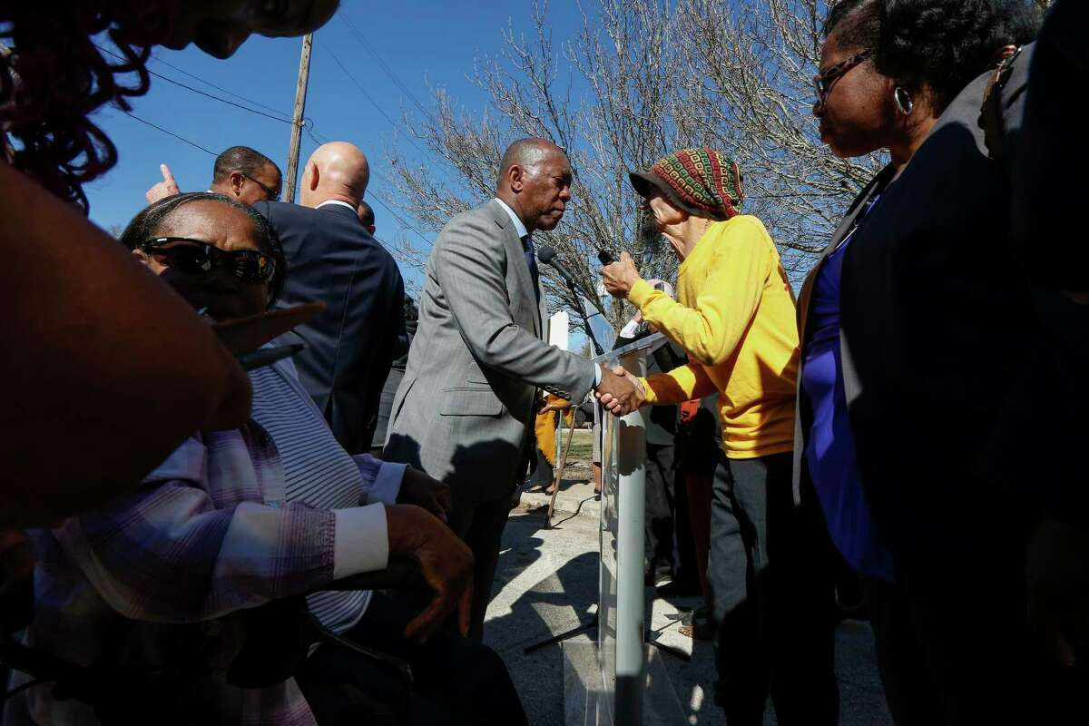 Mayor Sylvester Turner talks to concerned Acres Homes residents after holding a press conference opposing the expansion of a concrete batch plant near homes in Acre Homes Tuesday, Jan. 7, 2020, in Houston.