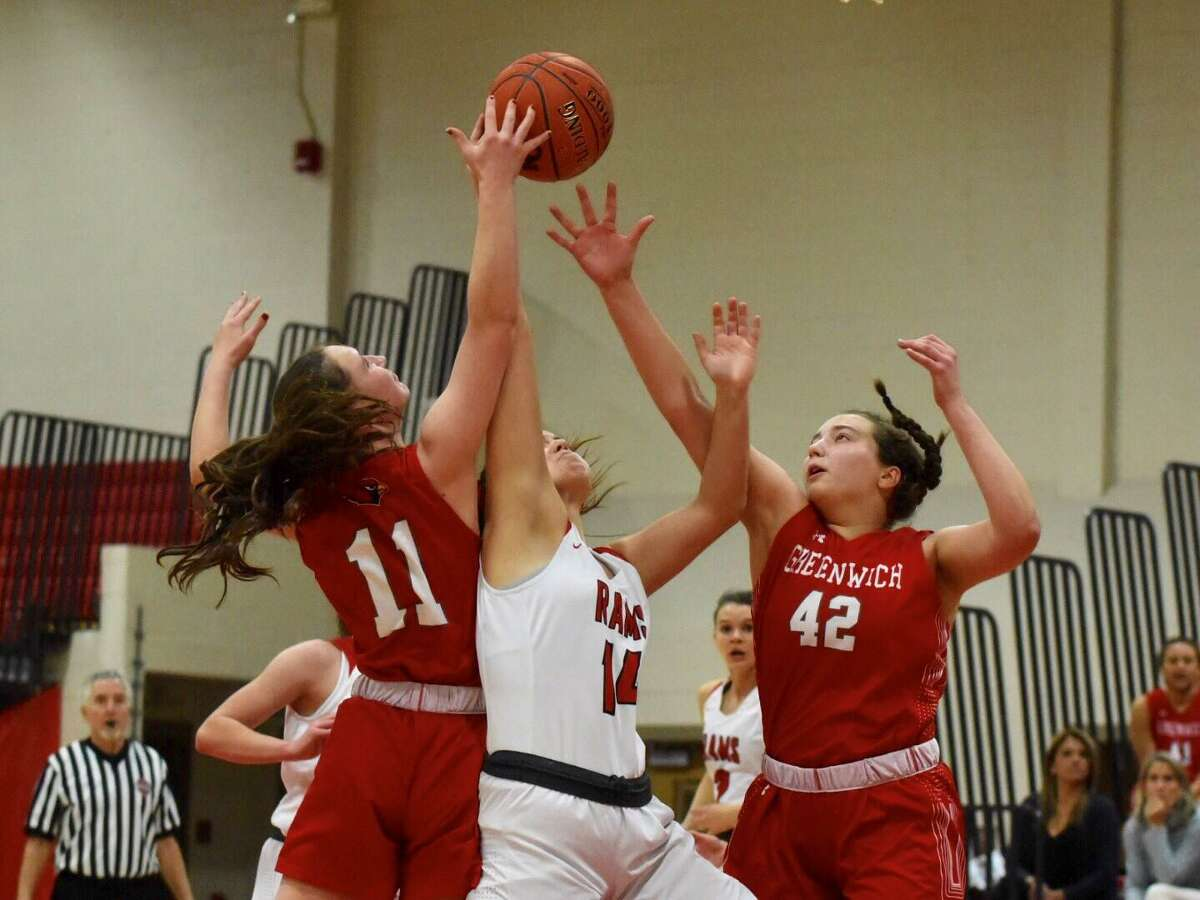 Greenwich's Kayla Anderson (42) and Kristin Riggs (11), and New Canaan's Kearney McKiernan (15) go up for a rebound during a girls basketball game at New Canaan High School on Tuesday, Jan. 7, 2020.