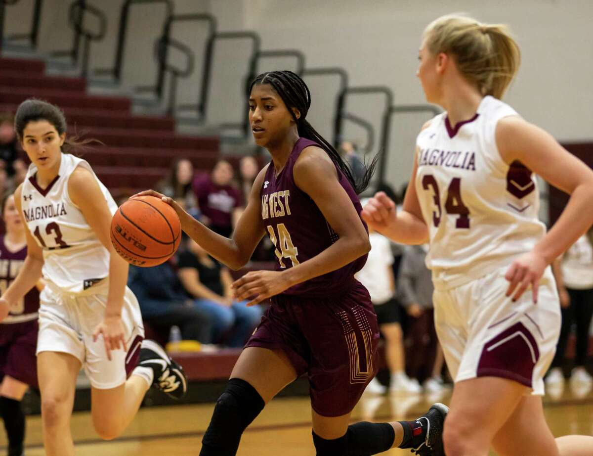 Magnolia West forward Kamryn Jones (44) drives the ball in a District 19-5A girls basketball game against Magnolia High School in Magnolia on Tuesday, Jan. 7, 2020.