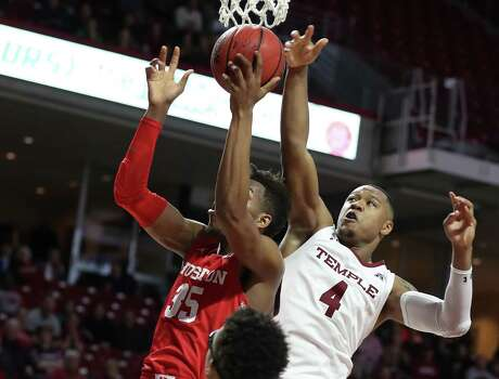 Fabian White, left, of Houston beats J.P. Moorman, right, of Temple to a rebound during the 2nd half at the Liacouras Center on Jan 7, 2020. Houston had a huge rebounding margin.