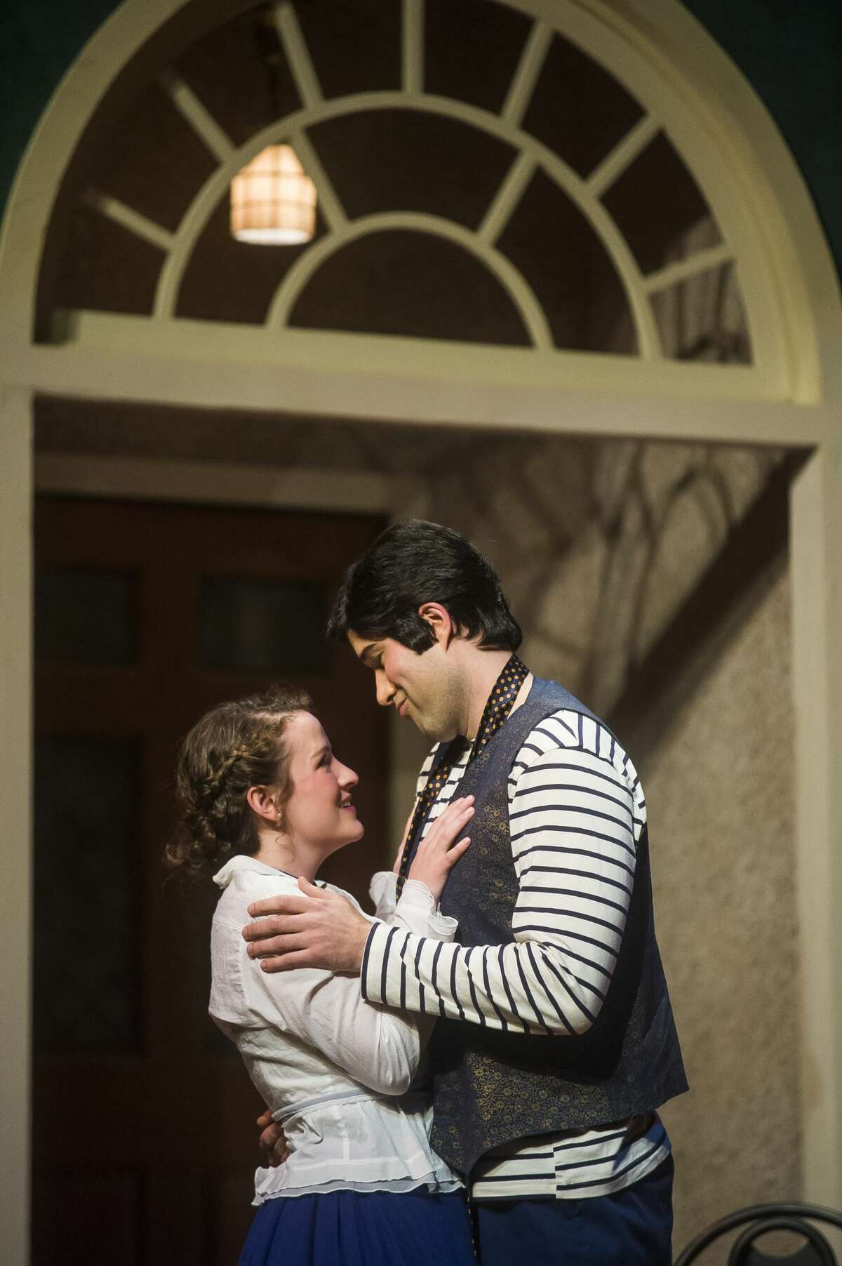 """Madeline Vallazza in the role of Suzanne, left, and Stephen Fort in the role of Picasso, right, act out a scene during a dress rehearsal Tuesday, Jan. 7, 2020 for Center Stage Theatre's production of """"Picasso at the Lapin Agile"""" at Midland Center for the Arts. (Katy Kildee/kkildee@mdn.net)"""