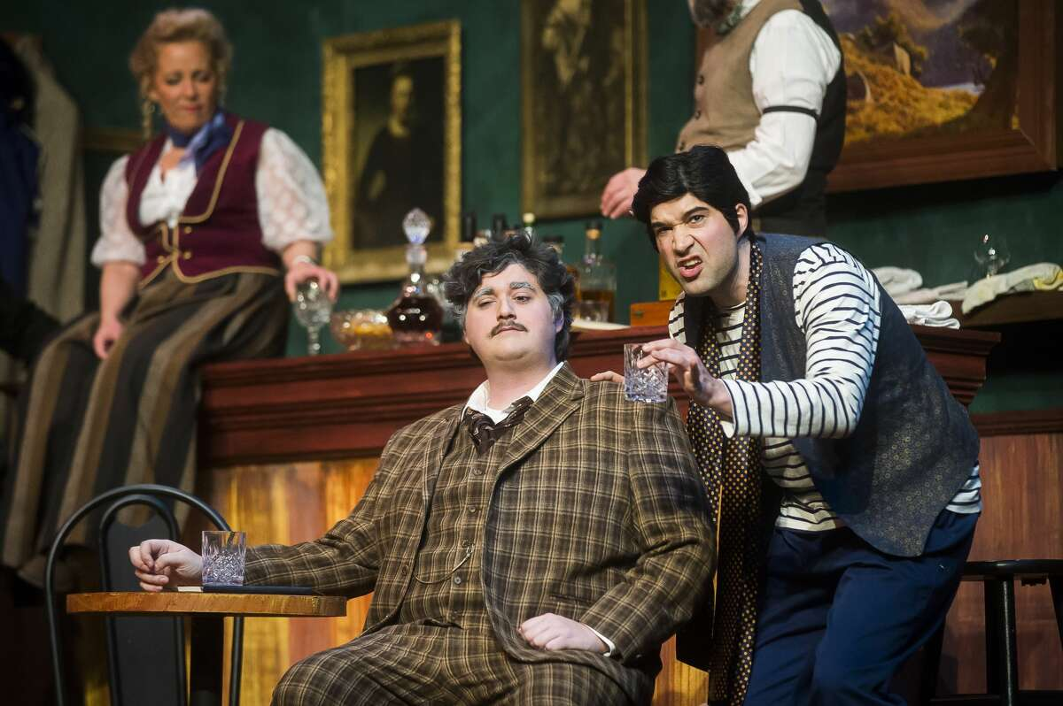 """Stephen Fort in the role of Picasso, right, and Kyle Sanborn in the role of Einstein, left, act out a scene during a dress rehearsal Tuesday, Jan. 7, 2020 for Center Stage Theatre's production of """"Picasso at the Lapin Agile"""" at Midland Center for the Arts. (Katy Kildee/kkildee@mdn.net)"""
