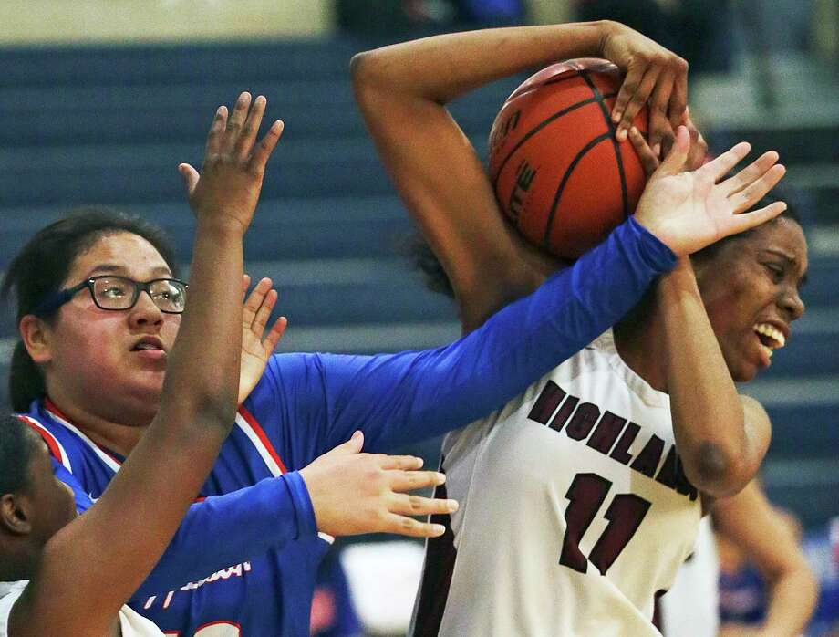 Owls forward Iyana Clay rips a rebound away from Eliana Rocha as Highlands plays Jefferson at Lanier High School gym in girls basketball on Jan. 7, 2020. Photo: Tom Reel, San Antonio Express-News / Staff Photographer / **MANDATORY CREDIT FOR PHOTOG AND  SAN ANTONIO EXPRESS-NEWS/NO SALES/MAGS OUT/TV