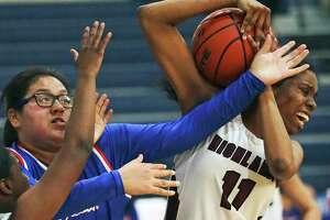 Owls forward Iyana Clay rips a rebound away from Eliana Rocha as Highlands plays Jefferson at Lanier High School gym in girls basketball on Jan. 7, 2020.