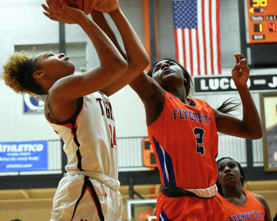 Edwardsville forward Ariana Bennet goes up for a contested shot against East St. Louis Jailah Perry in the fourth quarter Tuesday in Edwardsville. Photo: Matt Kamp|The Intelligencer