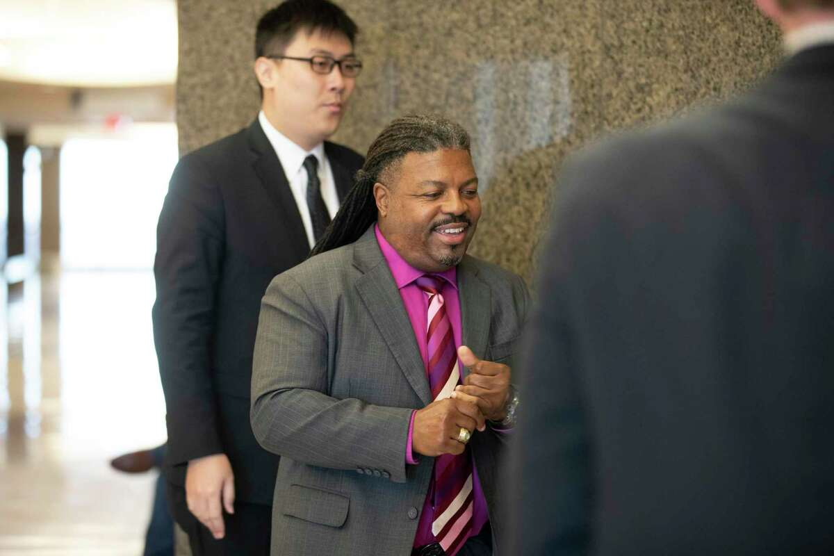 351st District Judge George Powell, center, enters the Harris County 295th District Court on Tuesday, Jan. 7, 2020, in Houston. Powell has filed a lawsuit against the Harris County Democratic Party.