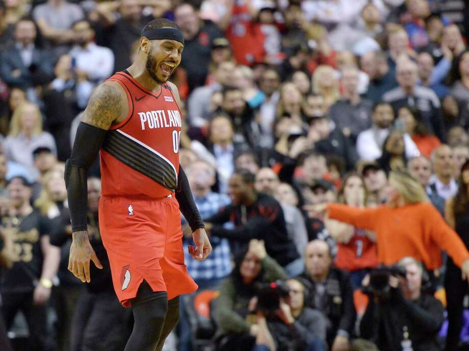 Trail Blazers forward Carmelo Anthony celebrates after sinking a go-ahead basket against the Toronto Raptors with four seconds left to give Portland a 101-99 win at Air Canada Centre in Toronto. Photo: Nathan Denette / Associated Press / The Canadian Press